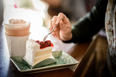 Strawberry cake in woman's hand Royalty Free Stock Photography