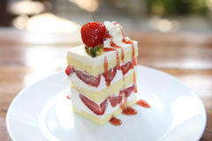 Strawberry Cake on wood Stock Images