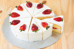 Strawberry cake on wooden background Royalty Free Stock Images