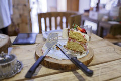 Strawberry cake on wooden table with knife, fork Stock Photos