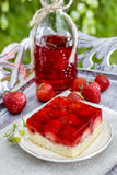 Strawberry cake on wooden tray in the garden Stock Photos