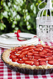 Strawberry cake on wooden tray in summer garden Stock Photo