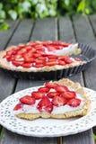 Strawberry cake on wooden tray in summer garden Stock Photos