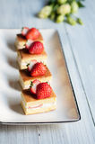 Strawberry cakes. Some delicious handmade strawberry cakes on the desk stock photos