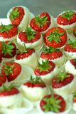 Strawberry candies. Strawberries dipped in white chocolate on display, selective focus Royalty Free Stock Images