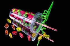 Strawberry candies in a glass and gummy bears royalty free stock photos