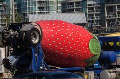 Strawberry cement mixer truck. Cement mixer truck decorated as a strawberry in Vancouver stock image