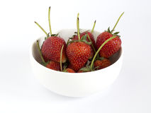 Strawberry. In ceramic bowl on white background Stock Photos