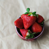 Strawberry in a ceramic cup. Strawberry in a ceramic cup on the craft paper. Top view, place for text Stock Photography