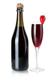 Strawberry champagne bottle and glass Stock Photos