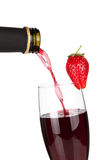 Strawberry champagne pouring down from a bottle Stock Photography