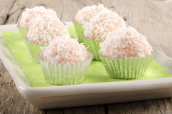 Strawberry champagne truffle with coconut flakes Stock Images