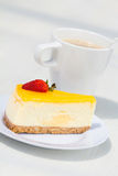 Strawberry cheese cake. Slice of strawberry cheese cake with a cup of coffee Stock Images