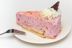 Strawberry cheese cake with chocolate heart on a white plate Royalty Free Stock Photo