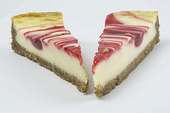 Strawberry cheese cake. Two slices of cake on a white back ground Royalty Free Stock Image