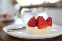 Strawberry cheese tart cake, Dessert. Strawberry cheese tart cake on a plate royalty free stock photography