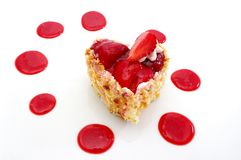 Strawberry Cheesecake. A delicious heart-shaped Strawberry Cheesecake. Shot on white Stock Photography