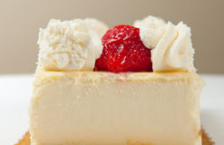 Strawberry cheesecake. Cheesecake dessert with strawberries and whipped cream Royalty Free Stock Photos