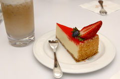 Strawberry Cheesecake. Cheesecake with beverage Royalty Free Stock Photography