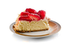 Strawberry Cheesecake. Slice of strawberry cheesecake on the plate over white background royalty free stock photography