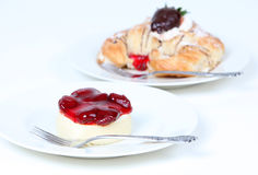 Strawberry cheesecake and croissant. Strawberry cheesecake and creme filled croissant with chocolate strawberry Royalty Free Stock Image
