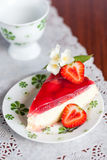 Strawberry cheesecake. Decorated with jasmine and a half of strawberry Stock Photo