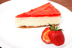 Strawberry cheesecake and fresh berries Stock Images