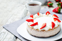 Strawberry cheesecake with fresh strawberries and whipped cream Stock Images