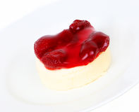 Strawberry cheesecake on plate. On a white background Royalty Free Stock Image