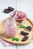 Strawberry cheesecake smoothie with cream cheese and milk, served with chocolate cookies Royalty Free Stock Photo