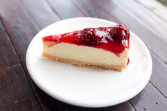 Strawberry Cheesecake. Cheesecake with strawberries on white plate Royalty Free Stock Photo