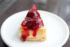 Strawberry Cheesecake. Cheesecake with strawberries on white plate Stock Photography