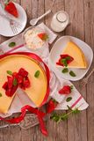 Strawberry cheesecake. Strawberry cheesecake on wooden table stock photography