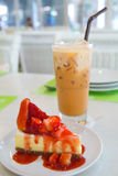 Strawberry Cheesecake. Yummy strawberry cheesecake with Thai milk tea Royalty Free Stock Images