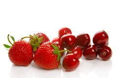 Strawberry and cherry Stock Images