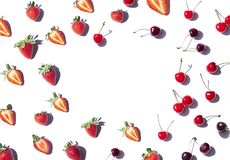 Strawberry and Cherry pattern frame on the noon light. Top view fresh berries on the white background. Copy space stock photos