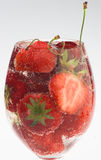 Strawberry and cherry in water Stock Image
