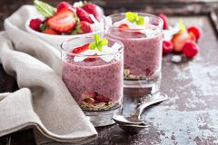 Strawberry chia pudding in glasses stock images
