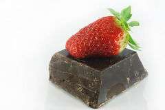 Strawberry and chocolate. On a white background Stock Images