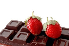 Strawberry and chocolate. A pair of strawberry on chocolate Royalty Free Stock Photography