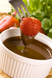 Strawberry in chocolate. Big red strawberry in chocolate Royalty Free Stock Image