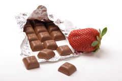 Strawberry and chocolate. A photo of fresh strawberry and a chocolate bar Stock Photography