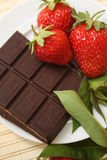Strawberry and chocolate. Delicious strawberry with chocolate on a plate Royalty Free Stock Image