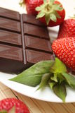 Strawberry and chocolate. Delicious strawberry with chocolate on a plate Stock Image