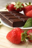 Strawberry and chocolate. Delicious strawberry with chocolate on a plate Royalty Free Stock Photos