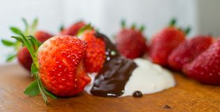 Strawberry with chocolate as dessert. Strawberry with chocolate as fresh bio dessert Royalty Free Stock Images