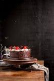 Strawberry Chocolate Cake on vintage wooden background. Dark foo Stock Photography