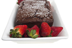 Strawberry chocolate cake on white plate Royalty Free Stock Images