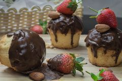 STRAWBERRY CHOCOLATE CUPCAKES WITH ALMONDS stock photography