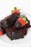 Strawberry Chocolate Dessert. Close up of a plate of chocolate cake with chocolate-covered strawberries for dessert Stock Images